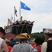 Spectators watching the relaunch of Mystic Seaport Museum's flagship the 1841 Whaleship Charles W. Morgan at the Henry B. duPont Preservation Shipyard at Mystic Seaport.  The ship, a National Historic Landmark and America's oldest commercial vessel, was carefully lowered into the water in a public ceremony to float on her own bottom for the first time since 2008. Mystic, Connecticut. 21st July 2013. Photo Tim Clayton