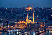 Skyline city scene Yeni Camii great mosque by Golden Horn of Bosphorus River and Hagia Sophia in Istanbul, Republic of Turkey