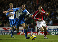 The FA Barclays Premiership<br />3 January 2005, Ewood Park, Blackburn<br />Blackburn Rovers v Charlton Athletic<br />Blackburn Rovers Lucas Neill tugs at Charlton Athletic's Danny Murphy's shirt during the match at Ewood Park<br />Pic Jason Cairnduff/Back Page Images