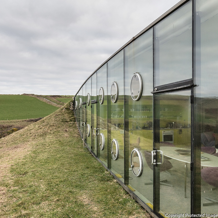 Malator open-plan living space. Architect: Future Systems. Druidston Haven, Pembrokeshire.