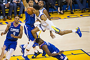 Golden State Warriors guard Patrick McCaw (0) goes horizontal while taking the ball to the basket against the LA Clippers at Oracle Arena in Oakland, Calif., on January 10, 2018. (Stan Olszewski/Special to S.F. Examiner)