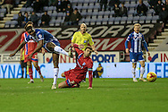 Donervon Daniels (Wigan) shoots during the Sky Bet League 1 match between Wigan Athletic and Gillingham at the DW Stadium, Wigan, England on 7 January 2016. Photo by Mark P Doherty.