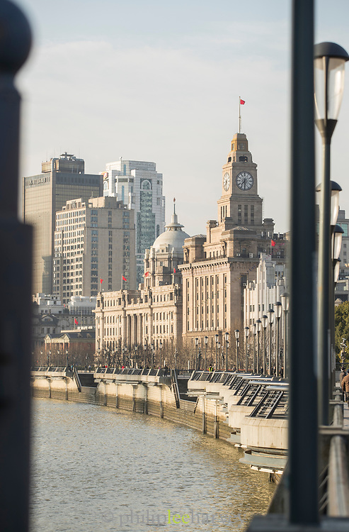 Shanghai cityscape with view of The Bund promenade and the Customs House with a clock tower, China