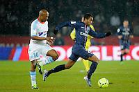 FOOTBALL - FRENCH CHAMPIONSHIP 2012/2013 - L1 - PARIS SAINT GERMAIN v OLYMPIQUE MARSEILLE - 24/02/2013 - PHOTO JEAN MARIE HERVIO / REGAMEDIA / DPPI - LUCAS MOURA (PSG) / ANDRE AYEW (OM)