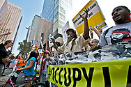 Occupy LA marching through the finacial district of Los Angeles to L.A city hall. Hundreds of simultanious marches are taking part around the globe, on an international day of action..