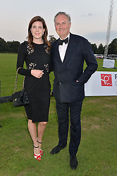MR WILLIAM & LADY LAURA CASH at the Chovgan Twilight Polo Gala in association with the PNN Group held at Ham Polo Club, Petersham Close, Richmond, Surrey on 10th September 2014.