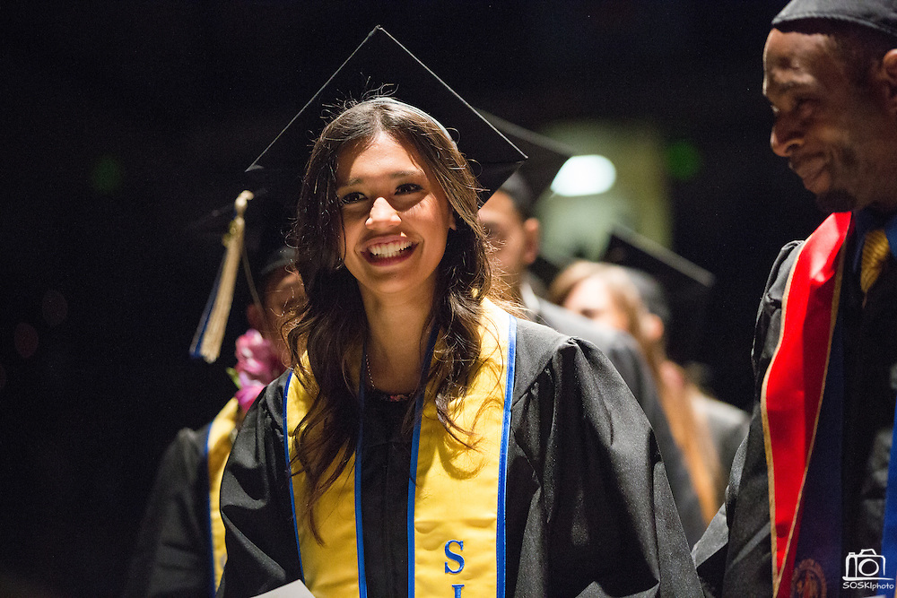 San Jose State students celebrate during the College of Business convocaton at San José State University's Event Center in San Jose, California, on May 24, 2013. (Stan Olszewski/SOSKIphoto)