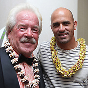 """Event organizer Phil Salick (left) poses with ASP World Surfing Champion Kelly Slater at the """"Taste of Brevard"""" event  and silent auction, during day two of the 28th annual National Kidney Foundation, Rich Salick Pro/Am surf festival on Friday,  September 1, 2013 in Cocoa Beach, Florida. This event raises thousands of dollars for people with kidney disease and also benefits the services of the NKF of Florida. (AP Photo/Alex Menendez)"""