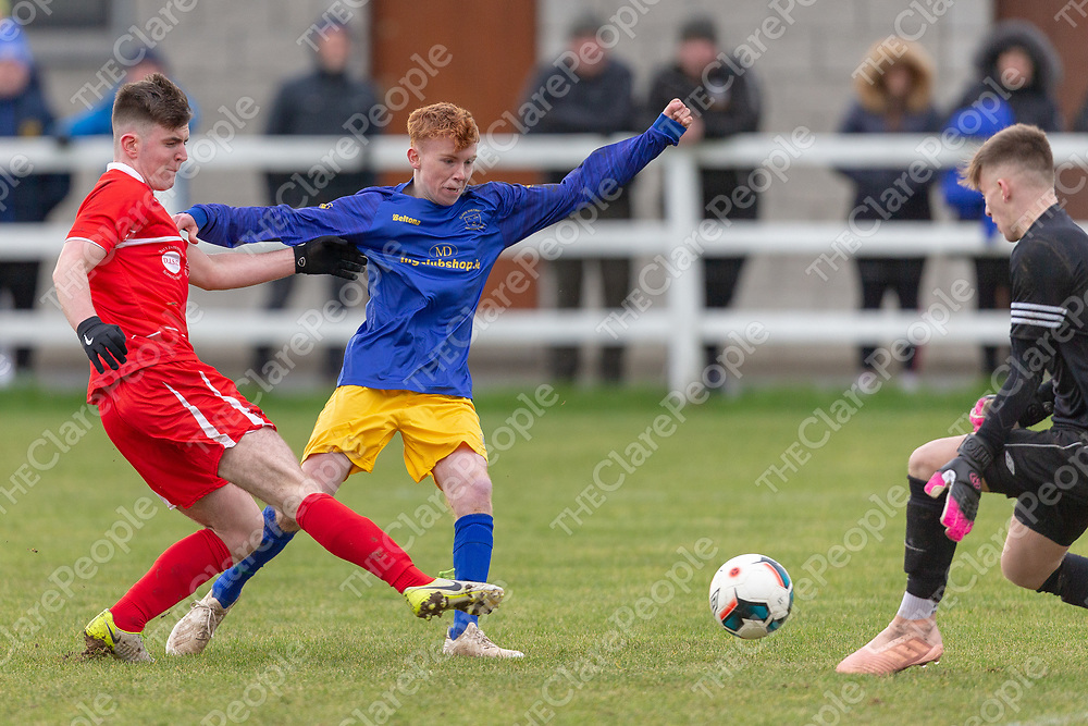 Clare's Ryan Barry is tackled by Cork's Tom O'Connell as he goes for goal