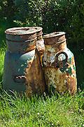 Old rusty galvanised iron milk creamery churns in County Clare, West of Ireland