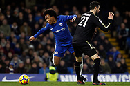 Vicente Iborra of Leicester City (R) fouls Willian of Chelsea (l). Premier League match, Chelsea v Leicester City at Stamford Bridge in London on Saturday 13th January 2018.<br /> pic by Steffan Bowen, Andrew Orchard sports photography.