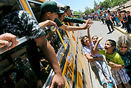 """Robin Zielinski – Sun-NewsOver 500 students and staff members from Columbia Elementary School gather in front of the school to cheer on the Mayfield High School baseball team as they head to Albuquerque to play Rio Rancho High School in quarterfinals of the Class 6A State Baseball Tournament. Pictured on the ground looking up from left to right, associate librarian Inez Lampkin, Brooklyn Pfaender, 6, Xavier Sandoval, 5, and associate librarian Babs Brunette. The game will be played today at 4 p.m. at University of New Mexico's Lobo Field. MHS player William Haywood said, """"This sendoff is so speacial because the kids look up to us like we are heros."""""""