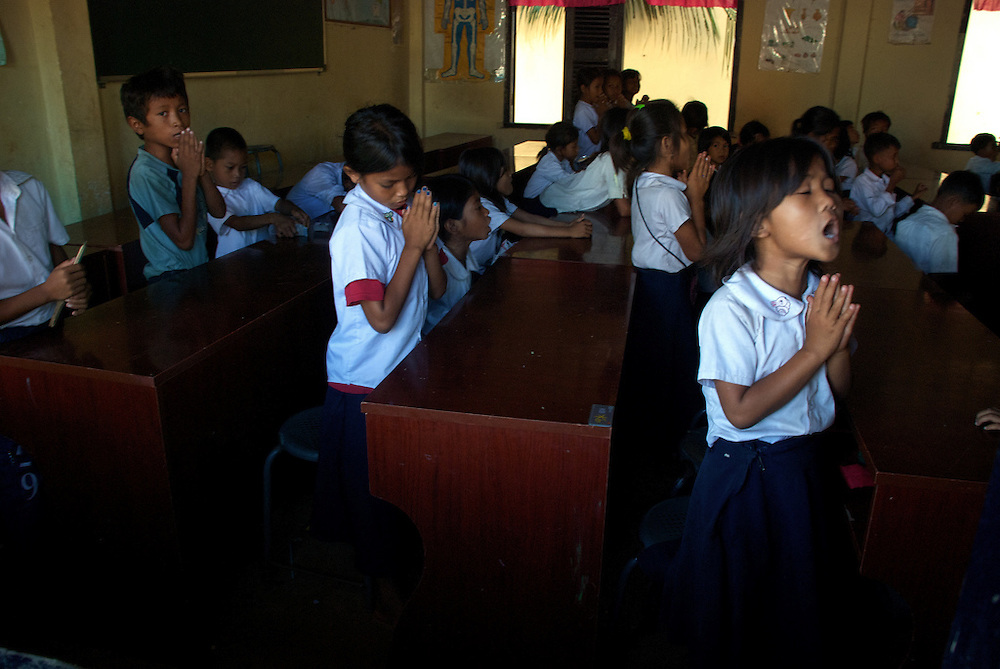 Primary school students sing in their classroom in the village at the base of Phnom Krom just outside of Siem Reap, Cambodia.