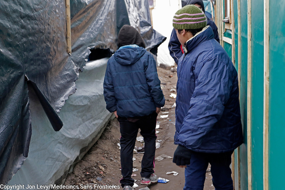 An 11-year-old unaccomapnied minor (L) from Afghanistan walks  back to his tent in the refugee camp in Calais. He claimed his father is in England and his mother had remained in Afghanistan.<br /><br />Calais: AA Gill visits the refugee camps of Calais and Grande Synthe in Dunkirk.