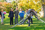 Old Westbury, New York, U.S. October 19, 2019. At right, docent LUCY JAFFE discusses the bronze resin sculpture Entangled, as she leads sculpture tour during Closing Reception for Polish sculptor Jerzy Kędziora (Jotka) Balance in Nature outdoor sculptures exhibit, held at Old Westbury Gardens.
