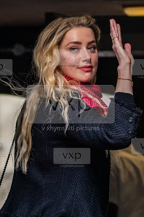 """Actress Amber Heard arrives at the High Court in London on Thursday, July 23, 2020. She will attend a hearing in Johnny Depp's libel case against the publishers of The Sun and its executive editor, Dan Wootton. <br /> 57-year-old Depp is suing the tabloid's publisher News Group Newspapers (NGN) over an article which called him a """"wife-beater"""" and referred to """"overwhelming evidence"""" he attacked Ms Heard, 34, during their relationship, which he strenuously denies. (VXP Photo/ Vudi Xhymshiti)"""