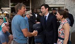 June 17, 2017 - Marietta, Georgia, U.S. -  JON OSSOFF, the Democratic candidate for Congress in Georgia's Sixth District, and his fiancee, ALISHA KRAMER, speak with voters at the NAACP Juneteenth Celebration.  Ossoff is competing again Republican candidate Karen Handel forthe open Congressional seat in a special election on June 20.(Credit Image: © Brian Cahn via ZUMA Wire)