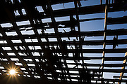 The sun bursts through the dilapidated roof of an abandoned barn in the Palouse Valley near Spokane, Washington.