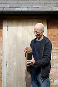 Furniture maker Adrian Swintead showing one of his wooden books outside his Maulden Woods office, Bedfordshire<br /> CREDIT: Vanessa Berberian for The Wall Street Journal<br /> GURU-SWINSTEAD