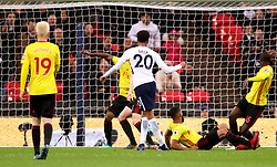 Tottenham Hotspur's Dele Alli (centre) scores his side's first goal of the game