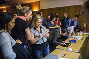 After the congregation, attendees are signing up to the mailing list and finding more information about The Sunday Assembly (today held inside Conway Hall in central London), an atheist service founded by British comedians Sanderson Jones and Pippa Evans in 2013, in London, England. The gathering is designed to bring together non-religious people who want a similar communal experience to a religious church. Satellite assemblies have been established in over 30 cities including New York, San Diego, and Dublin.