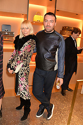 VIRGINIA BATES and JAMES LONG at the opening party for Moynat's new Maison de Vente in Mayfair at 112 Mount Street, London W1 on 12th March 2014.