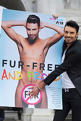 "© licensed to London News Pictures. London, UK 12/06/2013. X Factor finalist and Celebrity Big Brother star Rylan Clark revealing the new PETA Anti-Fur advert in a photocall in Marble Arch, London. The advert has ""No Fur"" logo with his naked picture as part of PETA's 'Let's Get One Thing Straight: Say No to Fur' campaign. Photo credit: Tolga Akmen/LNP"