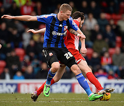 Swindon's Michael Smith and Orient's Romain Vincelot compete for the ball - Photo mandatory by-line: Mitchell Gunn/JMP - Tel: Mobile: 07966 386802 22/02/2014 - SPORT - FOOTBALL - Brisbane Road - Leyton - Leyton Orient V Swindon Town - League One