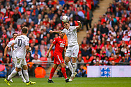 AFC Flyde defender Jordan Tunnicliffe (5) heads clear during the FA Trophy final match between AFC Flyde and Leyton Orient at Wembley Stadium on 19 May 2019.