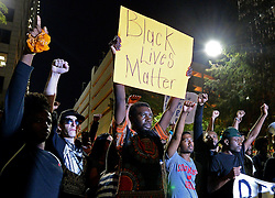 September 23, 2016 - Charlotte, NC, USA - Protesters stand in unity in Romare Bearden Park as they prepare to march throughout the city of Charlotte, N.C., on Friday, Sept. 23, 2016, as demonstrations continue following the shooting death of Keith Scott by police earlier in the week. (Credit Image: © Jeff Siner/TNS via ZUMA Wire)