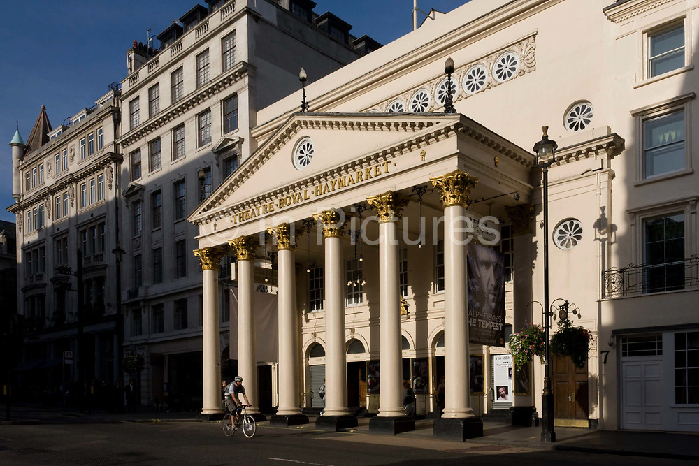 London's Theatre Royal in the capital's Haymarket, currently showing Shakespeare's The Tempest starring Ralph Fiennes. The Theatre Royal Haymarket (also known as Haymarket Theatre or the Little Theatre) is a West End theatre in the Haymarket in the City of Westminster that dates back to 1720, making it the third-oldest London playhouse still in use. Samuel Foote acquired the lease in 1747, and in 1766 he gained a royal patent to play legitimate drama (meaning spoken drama, as opposed to opera, concerts or plays with music) in the summer months. The original building was a little further north in the same street. It has been at its current location since 1821, when John Nash redesigned it. It is a Grade I listed building, with a seating capacity of 888.