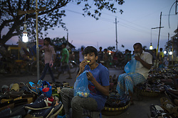 June 3, 2017 - Dhaka, Bangladesh - Muslims have a fast-breaking meal on the holy month of Ramadan on street in Dhaka, Bangladesh on June 03, 2017. (Credit Image: © Zakir Hossain Chowdhury/NurPhoto via ZUMA Press)