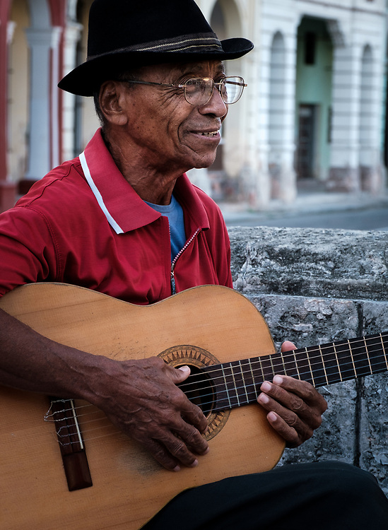 HAVANA, CUBA - CIRCA JANUARY 2020: Cuban man playing guitar in Paseo del Prado.