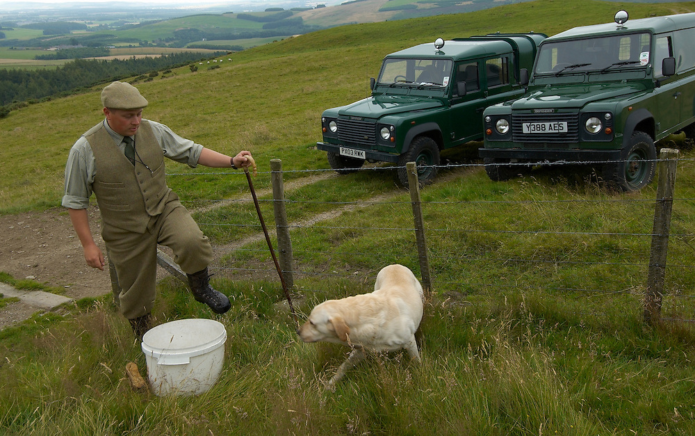 The gamekeeper Gavin Hannam  of Glen Lethnot estate  disinfects his footgear during the final checks and preparations in the build up  to the Glorious 12th, the official start of the red grouse shooting season (this year Monday 13th August)  ANGUS, SCOTLAND AUG 10 ..The Glorious Twelfth is usually used to refer to August 12, the start of the open season for grouse shooting in the United Kingdom. This is one of the busiest days in the shooting season, with large amounts of game being shot. It is also a major boost to the rural economy. ..Since the start of the season traditionally does not begin on a Sunday, it is sometimes postponed to August 13, as in 2001 . In recent years, the event has been hit by hunt saboteurs, the 2001 foot and mouth crisis (which further postponed the date in affected areas ) and the effect of sheep tick and the gut parasite Trichostrongylus tenius...The Game Conservancy Trust conducts scientific research into Britain's game and wildlife. Advising farmers and landowners on improving wildlife habitat and lobbying for agricultural and conservation policies based on science..Many of their  supporters take part in field sports.