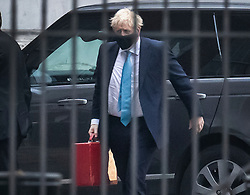© Licensed to London News Pictures. 19/10/2020. London, UK. Prime Minister Boris Johnson arrives at the back of Downing Street after a weekend at Chequers.  Photo credit: Peter Macdiarmid/LNP