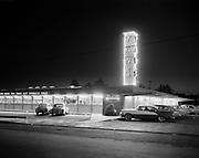 "Ackroyd 07529-09. ""J. Walter Thompson. Yaws & Irelands restaurants. March 21, 1957"" (restaurant kitchens, cooks, infra-red food servers) Yaws restaurant 2001 NE 40th"