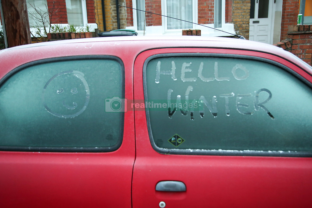 November 22, 2018 - London, United Kingdom - Hello Winter and a smiley face, is seen on a car windscreen covered in frost in London following a very cold night. .According to The Met Office blizzards and freezing temperatures are set to arrive in Britain next week as an Arctic blast sweeps across the country. Temperatures are likely to plunge to -10C and the bitter freeze - with gales from Siberia and heavy snow - is expected to last through Christmas. (Credit Image: © Dinendra Haria/SOPA Images via ZUMA Wire)