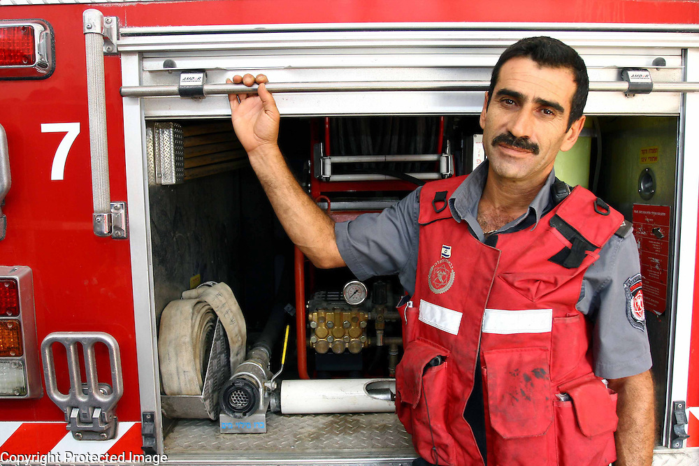 A firefighter from the Bet Shemesh area, Israel. Magazine portrait by Debbie Zimelman, Modiin, Israel
