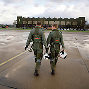 Two pilots of the 'Red Arrows', Britain's Royal Air Force aerobatic team return after training sortie.