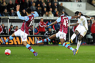 Swansea's Bafetimbi Gomis (far right) shoots at goal as the Aston Villa defence try to block it. Barclays Premier league match, Swansea city v Aston Villa at the Liberty Stadium in Swansea, South Wales on Saturday 19th March 2016.<br /> pic by  Carl Robertson, Andrew Orchard sports photography.