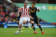 Glenn Whelan of Stoke City gets in front of Son Heung-Min of Tottenham Hotspur. Premier league match, Stoke City v Tottenham Hotspur at the Bet365 Stadium in Stoke on Trent, Staffs on Saturday 10th September 2016.<br /> pic by Chris Stading, Andrew Orchard sports photography.