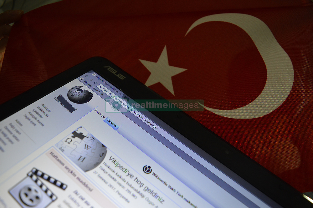 July 31, 2017 - Ankara, Turkey - In this photo illustration, a blocked Wikipedia page and a Turkish National flag are seen together in Ankara, Turkey on July 31, 2017. On April 29, the Turkish government blocked online access to Wikipedia in all languages across Turkey. After the ban, the Turkish Wikipedia logo was changed with a censor bar above the text as this version of the logo has been in use since the ban. (Credit Image: © Altan Gocher/NurPhoto via ZUMA Press)