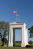 """The Peace Arch (1921) looking towards the USA.  Photographed from Peace Arch Provincial Park in Surrey, British Columbia, Canada.  The Peace Arch was built in 1921 to commemorate the 100 year anniversary of treaties at the end of the War of 1812 between the USA and Great Britain. One side states """"Children Of A Common Mother"""", the other """"Brethren Dwelling Together In Unity""""."""