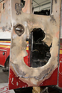 Detail of a destroyed emergency response vehicle that is part of a collection of artifacts saved from the site of the World Trade Center after 9/11. Artifacts chosen by curators out of the wreckage  from the World Trade Center  temporarily stored within an 80,000 square foot hanger at JFK airport, Hanger 17. Some of the artifacts will be in the National September 11 Memorial Museum set to open in 2012.