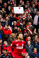 A Liverpool fan holds up a banner declaring his love for Mohamed Salah of Liverpool as the player celebrates scoring a goal to make it 3-0 - Mandatory by-line: Robbie Stephenson/JMP - 22/09/2018 - FOOTBALL - Anfield - Liverpool, England - Liverpool v Southampton - Premier League