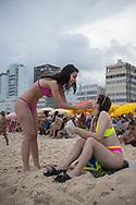 Rio de Janeiro, Brazil - March 5, 2019: Victoria and Paula, from the Brazilian city of Manuas, enjoy some time on Leblon Beach while visiting Rio de Janeiro for Carnival.