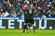 Riyad Mahrez (l) and Jamie Vardy of Leicester City celebrate after their 1st goal, a Mahrez shot deflected in off Fernando Fernandez of Swansea. . Premier league match, Swansea city v Leicester city at the Liberty Stadium in Swansea, South Wales on Saturday 21st October 2017.<br /> pic by Aled Llywelyn, Andrew Orchard sports photography.