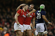 George North of Wales (l) celebrates with Jamie Roberts after he scores his teams 3rd try. RBS Six nations championship 2016, Wales v Scotland at the Principality Stadium in Cardiff, South Wales on Saturday 13th February 2016. <br /> pic by  Andrew Orchard, Andrew Orchard sports photography.