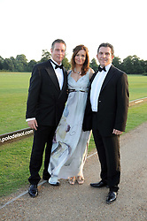 Left to right, CHRIS CHRISTODOULOU, and RICKY & LISA COOPER at the annual Ham Polo Club Summer Ball held at the club, Petersham Road, Richmond, Surrey on 25th July 2008.<br /> <br /> NON EXCLUSIVE - WORLD RIGHTS
