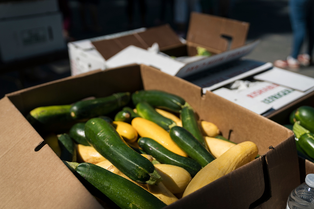 Boxes of fresh vegetables are stacked during a pop up grocery event at Powderhorn Park in Minneapolis, Minnesota, U.S., on Friday, July 24, 2020. Photographer: Ben Brewer/Bloomberg